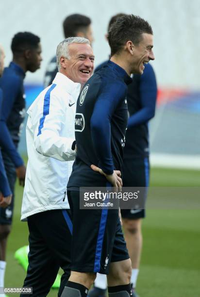Coach of France Didier Deschamps jokes with Laurent Koscielny during training session on the eve of the international friendly match between France...
