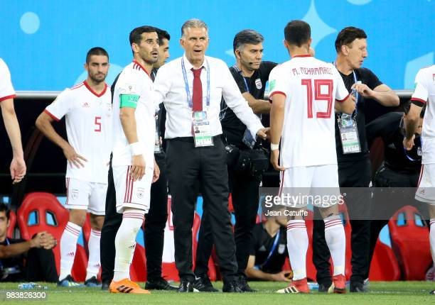 Coach of Iran Carlos Queiroz among his players during the 2018 FIFA World Cup Russia group B match between Iran and Portugal at Mordovia Arena on...