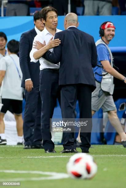 Coach of Japan Akira Nishino greets coach of Belgium Roberto Martinez following the 2018 FIFA World Cup Russia Round of 16 match between Belgium and...