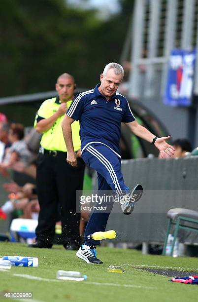 coach of Japan Javier Aguirre kicks a drink bottle during the Asian Cup practice match between Japan and Auckland City on January 4 2015 in Cessnock...