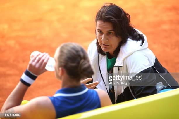 Coach of Karolina Pliskova of Czech Republic, Conchita Martinez gives her instructions during her match against Katerenya Kozlova of Ukraine during...