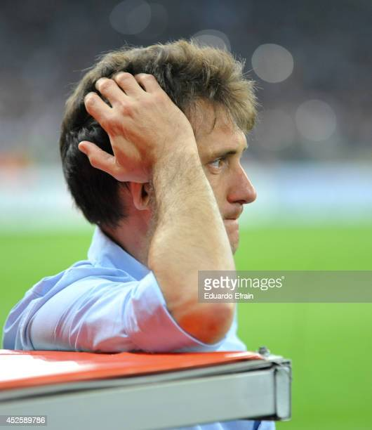 Coach of Lanus Guillermo Barros Schelotto looks dejected after his team loose the match between Atletico Mineiro and Lanús as part of the Recopa...