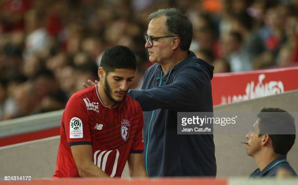 Coach of Lille Marcelo Bielsa greets Yassine Benzia of Lille during the preseason friendly match between Lille OSC and Stade Rennais FC at Stade...