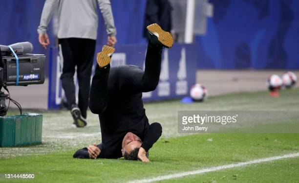 Coach of Lille OSC Christophe Galtier rolls over to celebrate the victory following the Ligue 1 match between Olympique Lyonnais and Lille OSC at...
