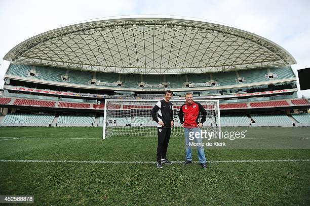 Coach of Malaga CF Javier Gracia Carlos stands with Coach of Adelaide United Josep Gombau after a press conference at Adelaide Oval on July 24 2014...