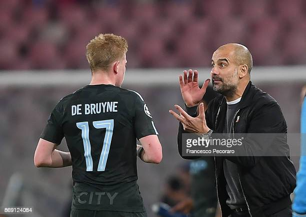 Coach of Manchester City Pep Guardiola and player Kevin De Bruyne during the UEFA Champions League group F match between SSC Napoli and Manchester...