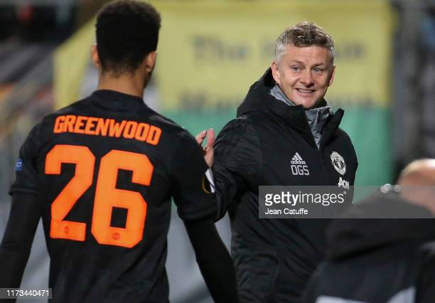 Coach of Manchester United Ole Gunnar Solskjaer greets Mason Greenwood of Manchester United when he's replaced during the UEFA Europa League group L...