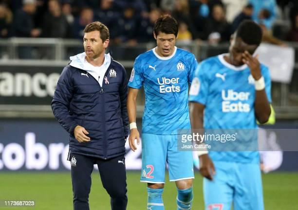 Coach of Marseille Andre Villas-Boas, Hiroki Sakai, Bouna Sarr of Marseille look dejected following the Ligue 1 match between Amiens SC and Olympique...