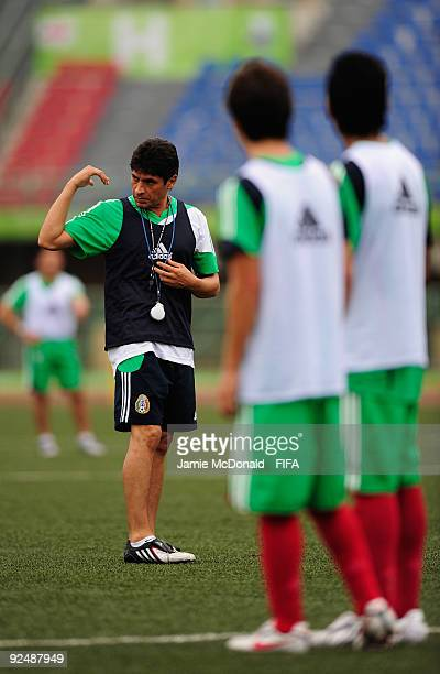 Coach of Mexico Jose Luis Gonzalez gives instructions to his players during a Mexico training session at the Teslim Balogun Stadium on October 29...