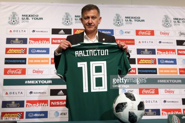 Coach of Mexico Juan Carlos Osorio poses holding a jersey during a press conference as part of Mexico US Tour 2018 on February 12 2018 in Arlington...