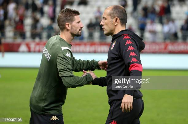 Coach of Monaco Leonardo Jardim greets Adrien Da Silva of Monaco and his players following the Ligue 1 match between Stade de Reims and AS Monaco at...