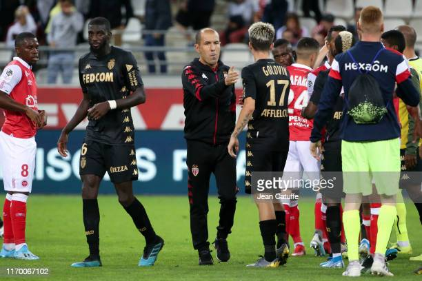 Coach of Monaco Leonardo Jardim greets Aleksandr Golovin of Monaco and his players following the Ligue 1 match between Stade de Reims and AS Monaco...