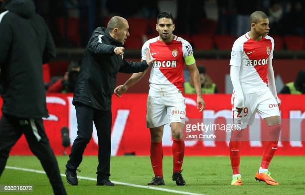 Coach of Monaco Leonardo Jardim talks to Radamel Falcao during the French Ligue 1 match between Paris Saint Germain and AS Monaco at Parc des Princes...