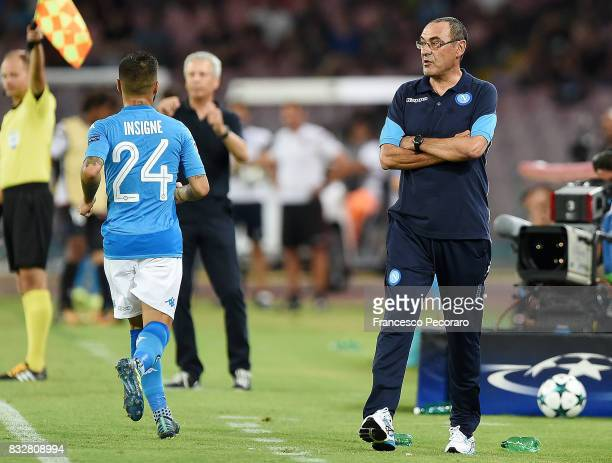 Coach of Napoli Maurizio Sarri and player Lorenzo Insigne during the UEFA Champions League Qualifying PlayOffs Round First Leg match between SSC...
