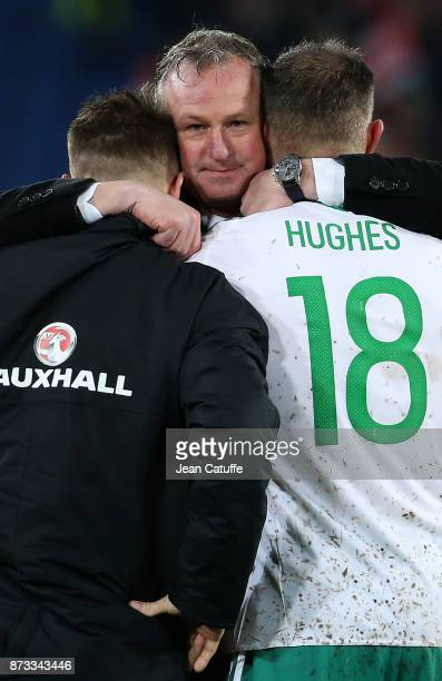 Coach of Northern Ireland Michael O'Neill consoles Oliver Norwood and Aaron Hughes following the FIFA 2018 World Cup Qualifier PlayOff Second Leg...