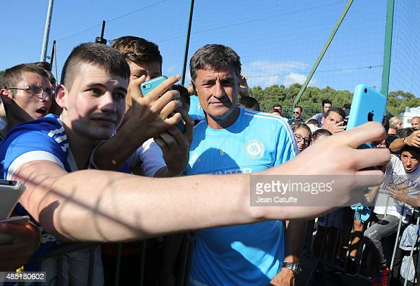 Coach of OM Jose Miguel Gonzalez Martin del Campo aka Michel greets the supporters before Olympique de Marseille's training session at Robert...