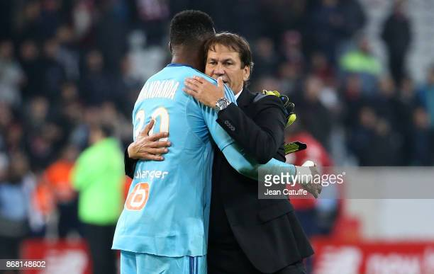 Coach of OM Rudi Garcia salutes goalkeeper of OM Steve Mandanda following the French Ligue 1 match between Lille OSC and Olympique de Marseille at...