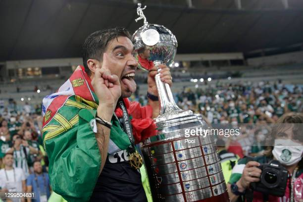 Coach of Palmeiras Abel Ferreira holds the Copa CONMEBOL Libertadores champions trophy after against Santos at Maracanã Stadium on January 30, 2021...