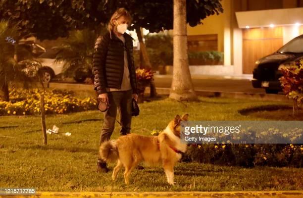 Coach of Peru national soccer team Ricardo Gareca walks his dog Almendra during the governmentordered lockdown on May 27 2020 in Lima Peru
