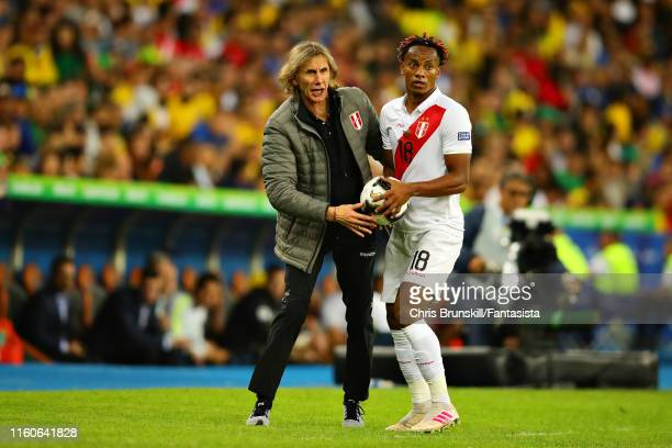 Coach of Peru Ricardo Gareca instructs his team from the sidelines as Andre Carrillo of Peru prepares to take a throw in during the Copa America...