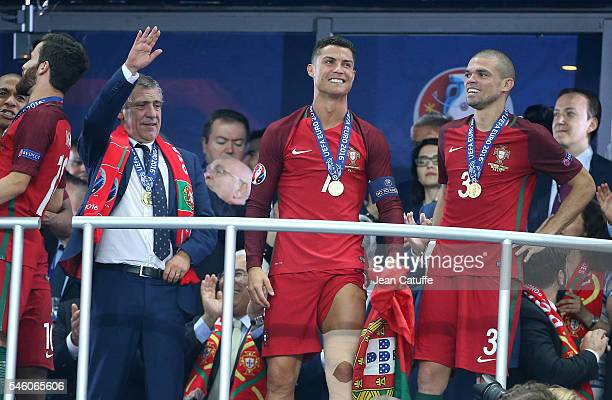 Coach of Portugal Fernando Santos Cristiano Ronaldo and Pepe of Portugal celebrate the victory during the trophy ceremony following the UEFA Euro...