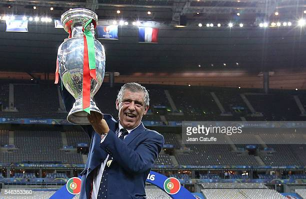 Coach of Portugal Fernando Santos holds the trophy following the UEFA Euro 2016 final between Portugal and France at Stade de France on July 10, 2016...