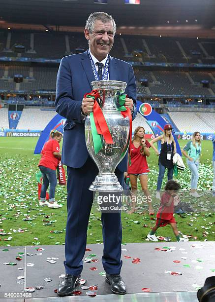 Coach of Portugal Fernando Santos poses with the trophy following the UEFA Euro 2016 final match between Portugal and France at Stade de France on...