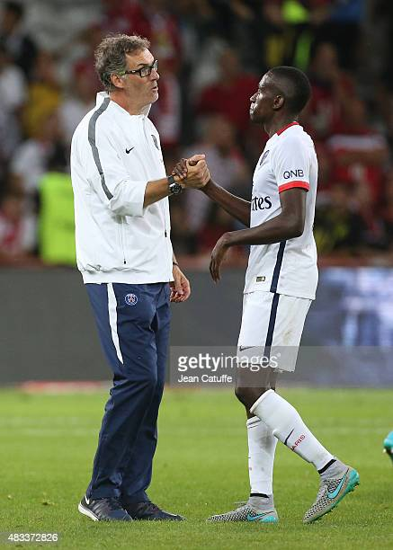Coach of PSG Laurent Blanc congratulates Blaise Matuidi of PSG after the French Ligue 1 match between Lille OSC and Paris SaintGermain at Grand Stade...