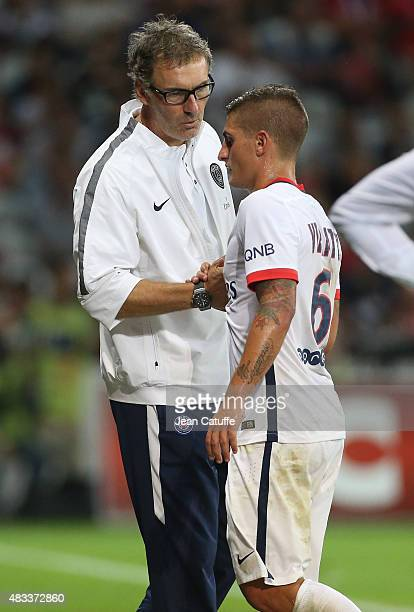 Coach of PSG Laurent Blanc congratulates Marco Verratti of PSG during the French Ligue 1 match between Lille OSC and Paris SaintGermain at Grand...