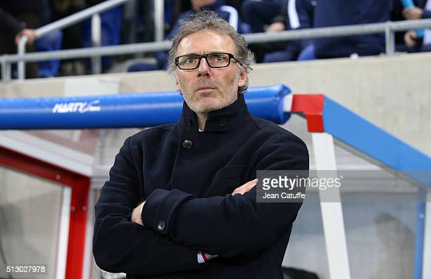 Coach of PSG Laurent Blanc looks on during the French Ligue 1 match between Olympique Lyonnais and Paris SaintGermain at Parc Olympique Lyonnais...