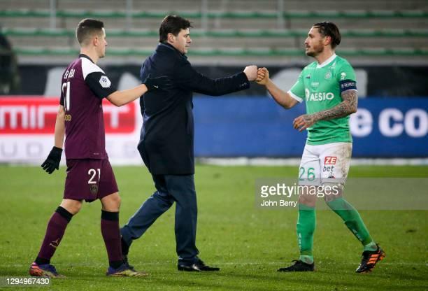 Coach of PSG Mauricio Pochettino salutes Mathieu Debuchy of Saint-Etienne following the Ligue 1 match between AS Saint-Etienne and Paris...