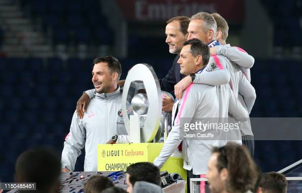 Coach of PSG Thomas Tuchel and his staff celebrate winning the 'French Championship 2018-2019' during the trophy ceremony following the French Ligue...