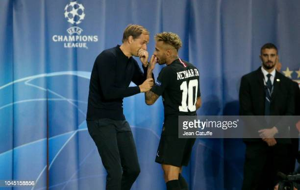 Coach of PSG Thomas Tuchel chats with Neymar Jr when he's replaced during the Group C match of the UEFA Champions League between Paris SaintGermain...