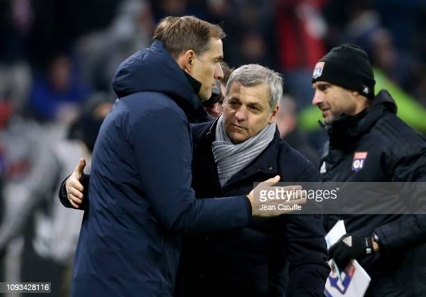 Coach of PSG Thomas Tuchel greets coach of Lyon Bruno Genesio following the french Ligue 1 match between Olympique Lyonnais and Paris SaintGermain at...