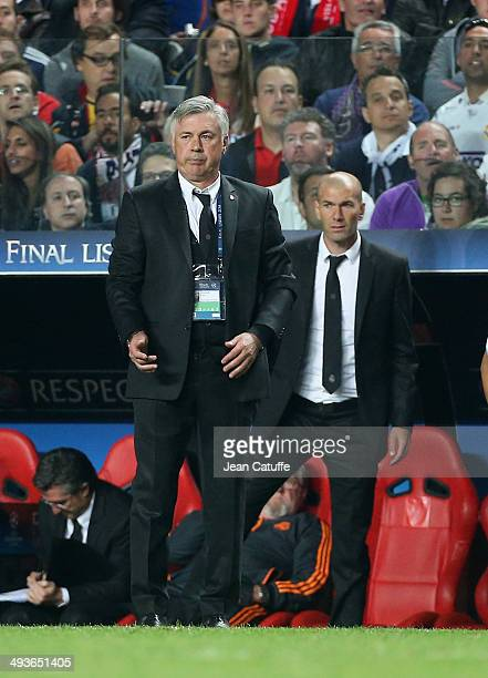 Coach of Real Madrid Carlo Ancelotti and his assistant Zinedine Zidane look on during the UEFA Champions League final between Real Madrid and...