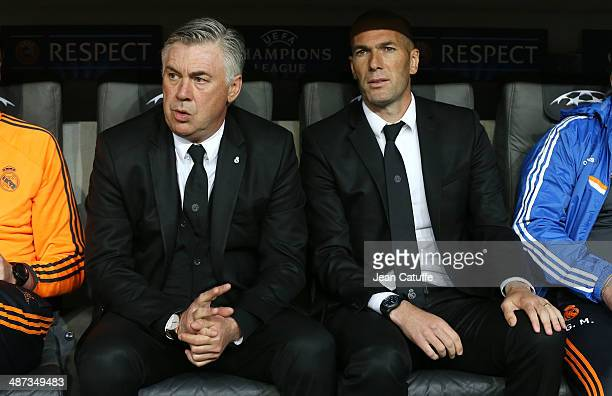 Coach of Real Madrid Carlo Ancelotti and his assistant Zinedine Zidane attend on the bench during the UEFA Champions League semifinal second leg...
