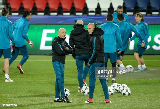 Coach of Real Madrid Zinedine Zidane and fitness coach Antonio Pintus during Real Madrid's training on the eve of UEFA Champions League match between...