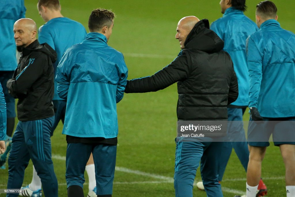 Coach of Real Madrid Zinedine Zidane jokes with Cristiano Ronaldo (left) during Real Madrid's training on the eve of UEFA Champions League match between Paris Saint Germain (PSG) and Real Madrid at Parc des Princes stadium on March 5, 2018 in Paris, .