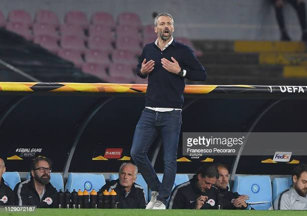 Coach of Red Bull Salzburg Marco Rose gestures during the UEFA Europa League Round of 16 First Leg match between S.S.C. Napoli and Red Bull Salzburg...