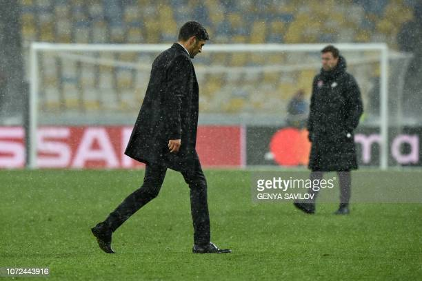 Coach of Shakhtar Donetsk Paulo Fonseca walks on the pitch after the UEFA Champions League Groupe F football match FC Shakhtar Donetsk and Olympique...