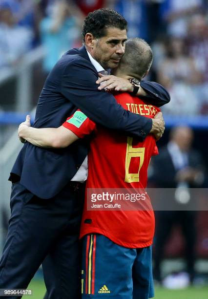 Coach of Spain Fernando Hierro Andres Iniesta dejected following the 2018 FIFA World Cup Russia Round of 16 match between Spain and Russia at...