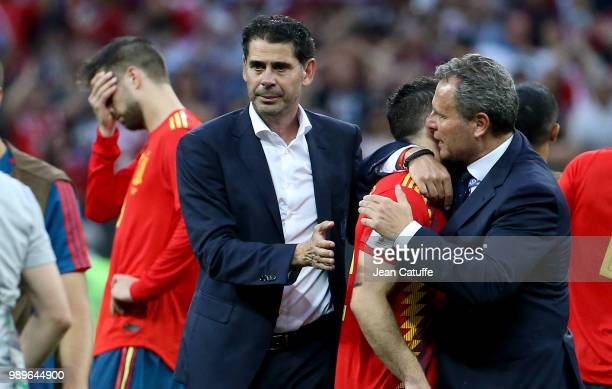 Coach of Spain Fernando Hierro Gerard Pique dejected following the 2018 FIFA World Cup Russia Round of 16 match between Spain and Russia at Luzhniki...