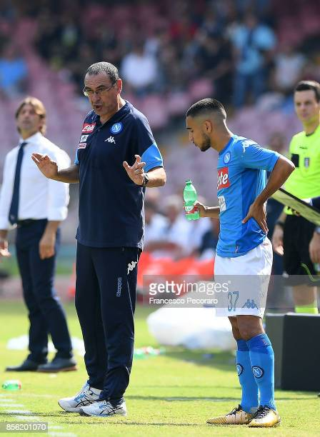 Coach of SSC Napoli Maurizio Sarri and player Adam Ounas during the Serie A match between SSC Napoli and Cagliari Calcio at Stadio San Paolo on...