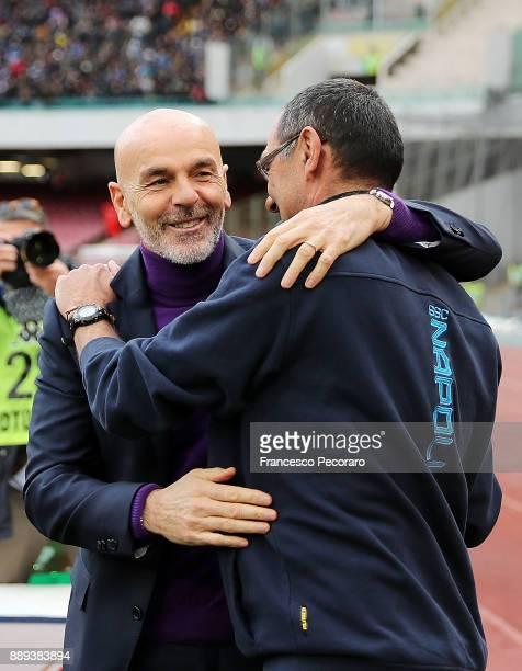 Coach of SSC Napoli Maurizio Sarri greets coach of ACF Fiorentina Stefano Pioli during the Serie A match between SSC Napoli and ACF Fiorentina at...