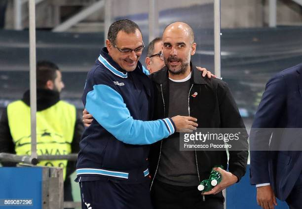 Coach of SSC Napoli Maurizio Sarri greets coach of Manchester City Pep Guardiola during the UEFA Champions League group F match between SSC Napoli...