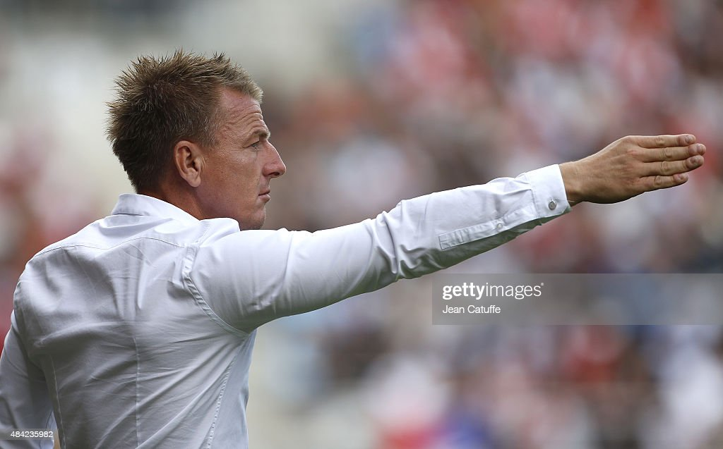 Coach of Stade de Reims Olivier Guegan reacts during the French Ligue 1 match between Stade de Reims and Olympique de Marseille (OM) at Stade Auguste Delaune on August 16, 2015 in Reims, France.