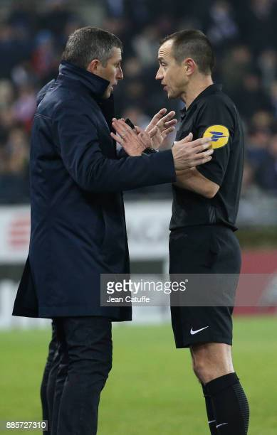 Coach of Strasbourg Thierry Laurey and referee Ruddy Buquet during the French Ligue 1 match between RC Strasbourg Alsace and Paris Saint Germain at...