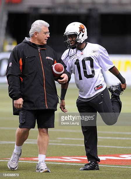 Coach of the BC Lions Wally Buono talks with Kierrie Johnson during practice at BC Place on November 23 2011 in Vancouver Canada