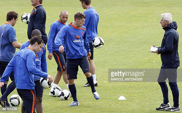 Coach of the Dutch national football team Bert van Marwijk watches as his players warm up during a team training session on June 9 2009 in Katwijk...