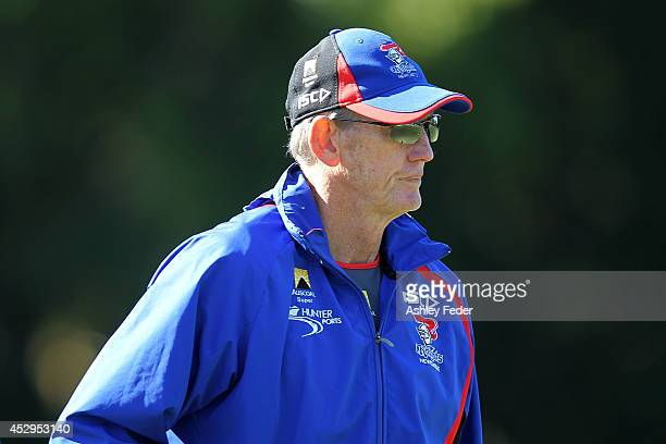 Coach of the Knights Wayne Bennett instructs his players during a Newcastle Knights NRL training session on July 31 2014 in Newcastle Australia